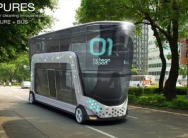 Autobusas, valantis orą mieste