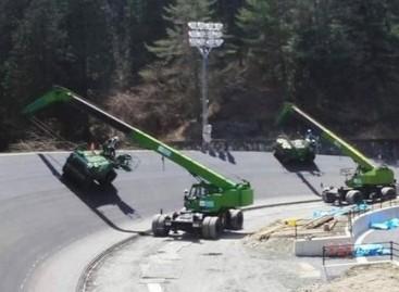 Kaip klojamas asfaltas nuožulniose lenktynių trasos atkarpose?