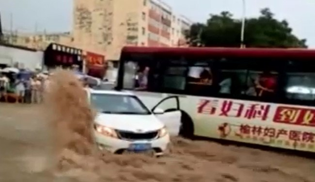 VIDEO: Bus Driver Saves 3 from Torrential Flood on Street in China